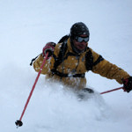 powder skiing photo in the alps on a ski tour