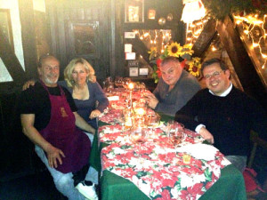 Dario, Deb, John Frasca (VP of Ski.com, our partner for our Euro trips) and Francesco Camoti (Director of Tourism, Madesimo) enjoy a meal at Dario's restaurant, which will serve you lunch on the snowmobile day.