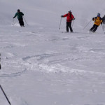 More of the crew skiing on a glacier.