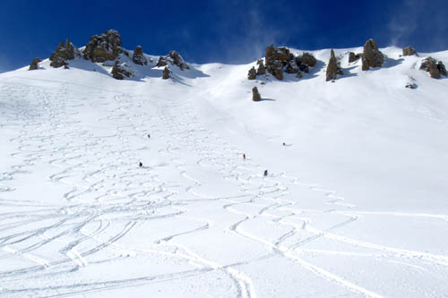 When it dumps, there are always fresh tracks to be had, even right next to lifts. Our tracks laid down on a pow day in the Sestriere region years ago.