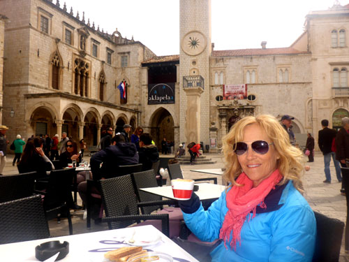 Taking a break in a lovely Dubrovnik square.