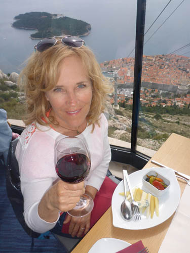 Cheers from Deb as she soaks in the view from the top of tram looking down on Dubrovnik. Great fun!