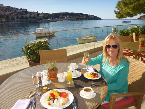 Believe it or not, this is the view from your hotel in Hvar. Deb enjoys an included champagne breakfast buffet at the hotel Adiana.