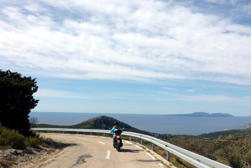 Motorcycle Mamma Deb enjoying a super curvy, super fun ride on Hvar Island.