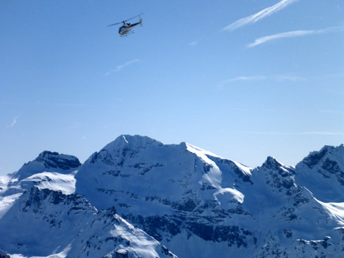 Heli coming in for a landing at 12,400 feet on Grantz Glacier. It is the highest heli flight available in Europe.