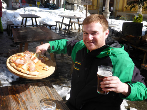 Ryan with a well-deserved pizza and beer after a BIG Alagna backcountry run.