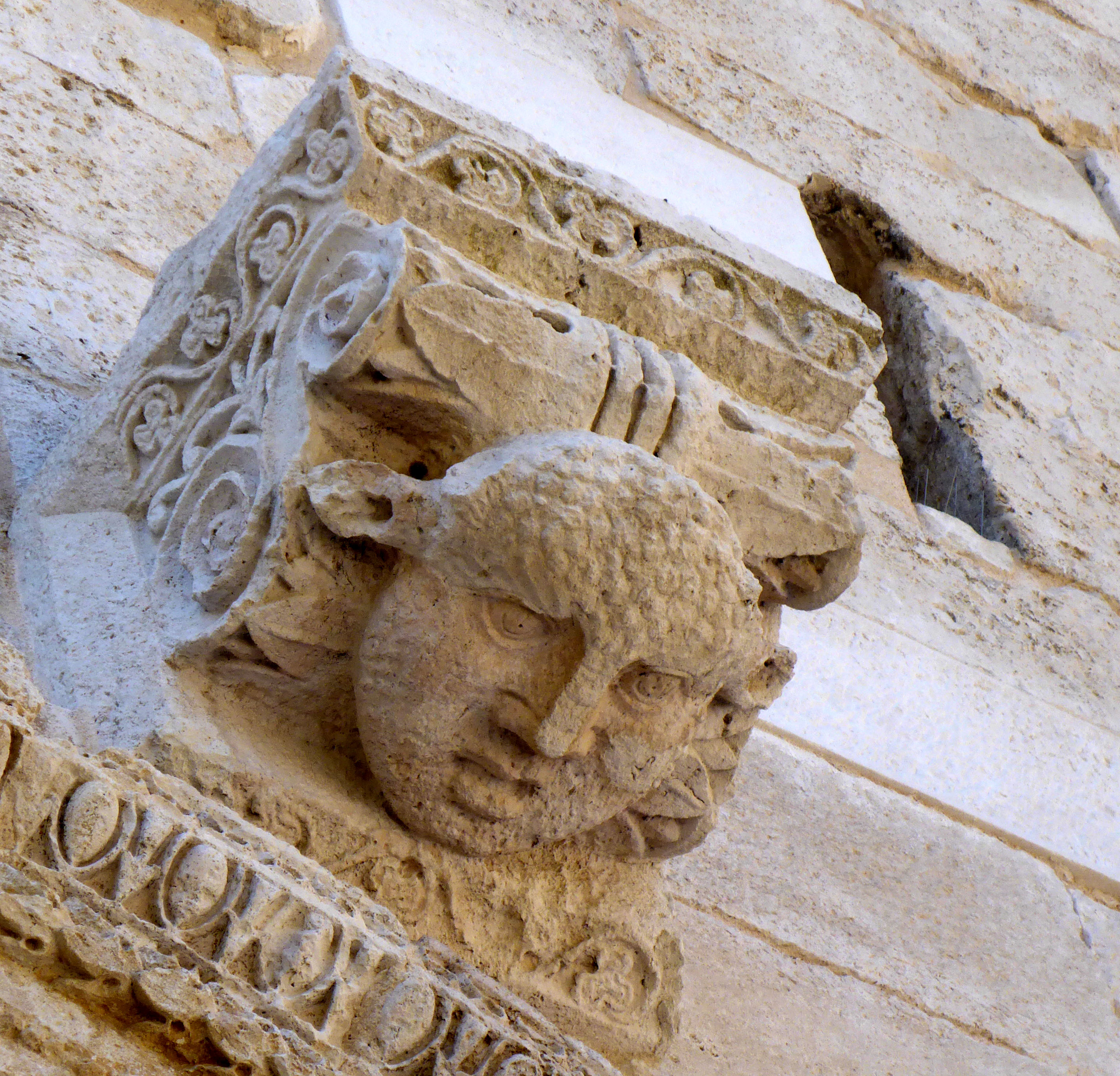 Unrestored 1800 year old statue head over one of the city wall gates.