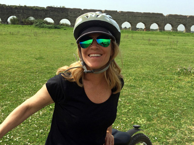 Deb's smile says it all. What a wonderful day the Appian Way bike tour is. Riding along a 2,000 year old Roman road and aqueducts, with a visit to a Catacomb and a goat farm for some cheese and wine: this tour has all this and more and is included in our Rome package.