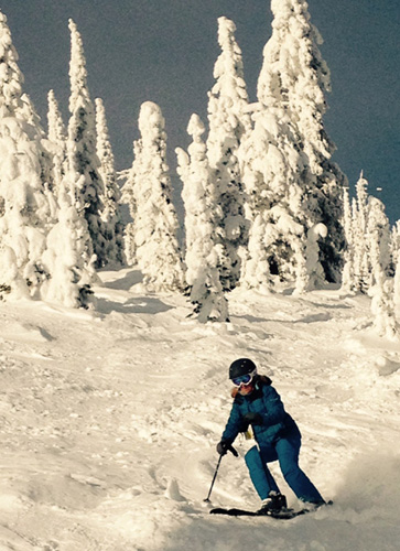 Deb lapping up some nice B.C. powder on one of many wide-open tree glades at Red Mountain a couple of years ago.