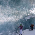 Deb dwarfed by a huge wall of glacial ice.