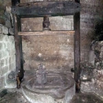 Ancient olive oil press in the caves.