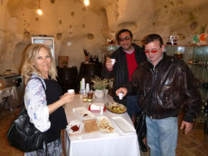 Deb sampling some delicious specialties in a Matera cave house. So fun!