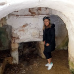 Deb checks out the fireplace of a very old, very abandoned trulli.